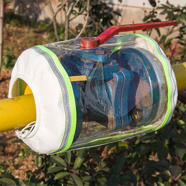 PVC flange spray shield for expansion valve